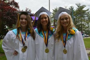 The OLSH 2018 salutatorian and co-valedictorians pose on graduation day