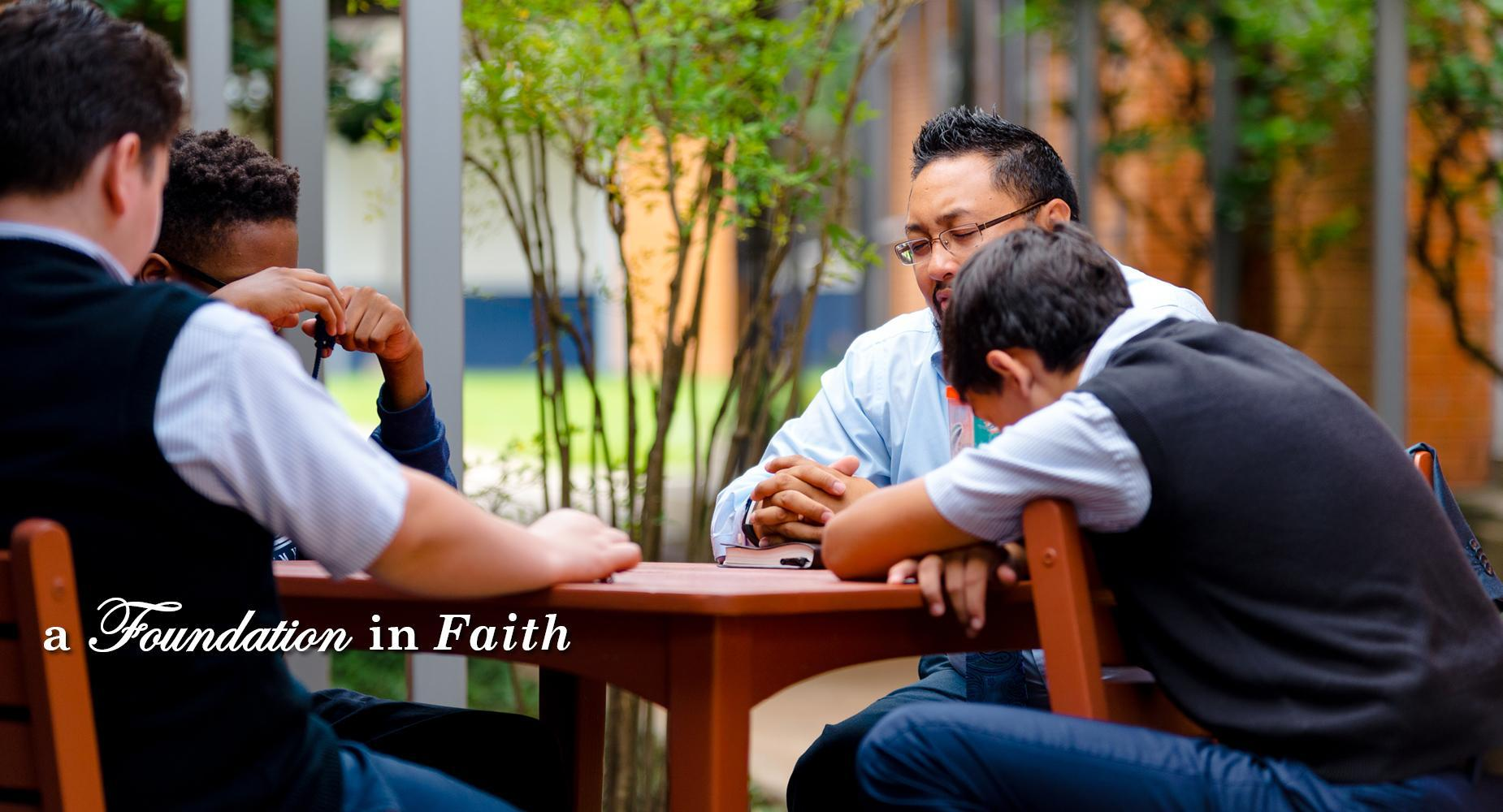 a foundation in faith with students and teacher praying together