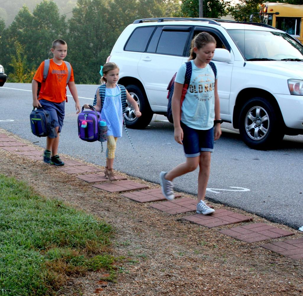 Students arrive for the first day of school at Mt. Pleasant Elementary.