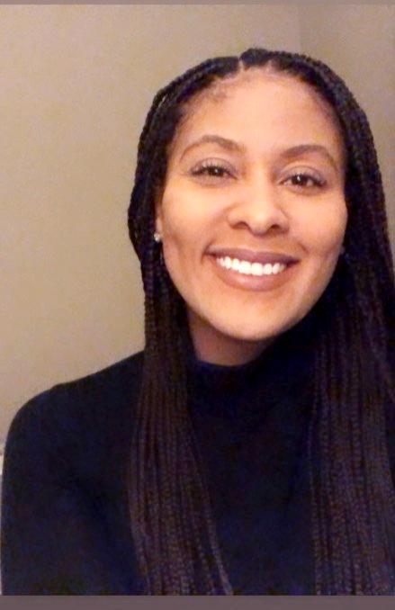 Informal photo of Amanda Hoover, smiling, face only, slightly off center