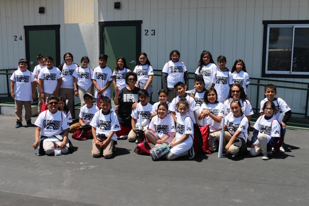 fifth graders and Ms. Murillo pose with Ms. Wright