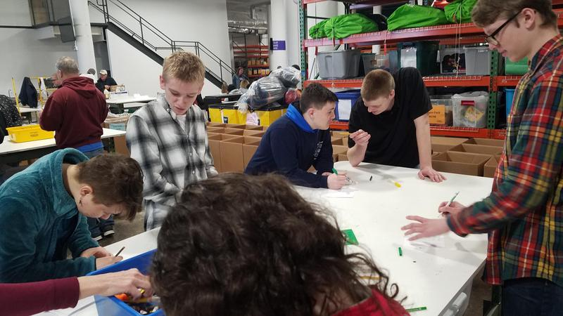 ET1 Students Volunteer at Cradles to Crayons Featured Photo