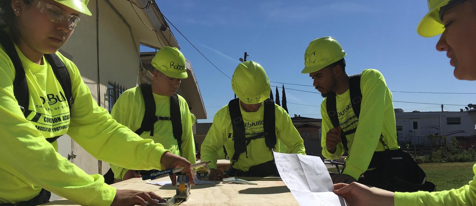 Construction students making measurements