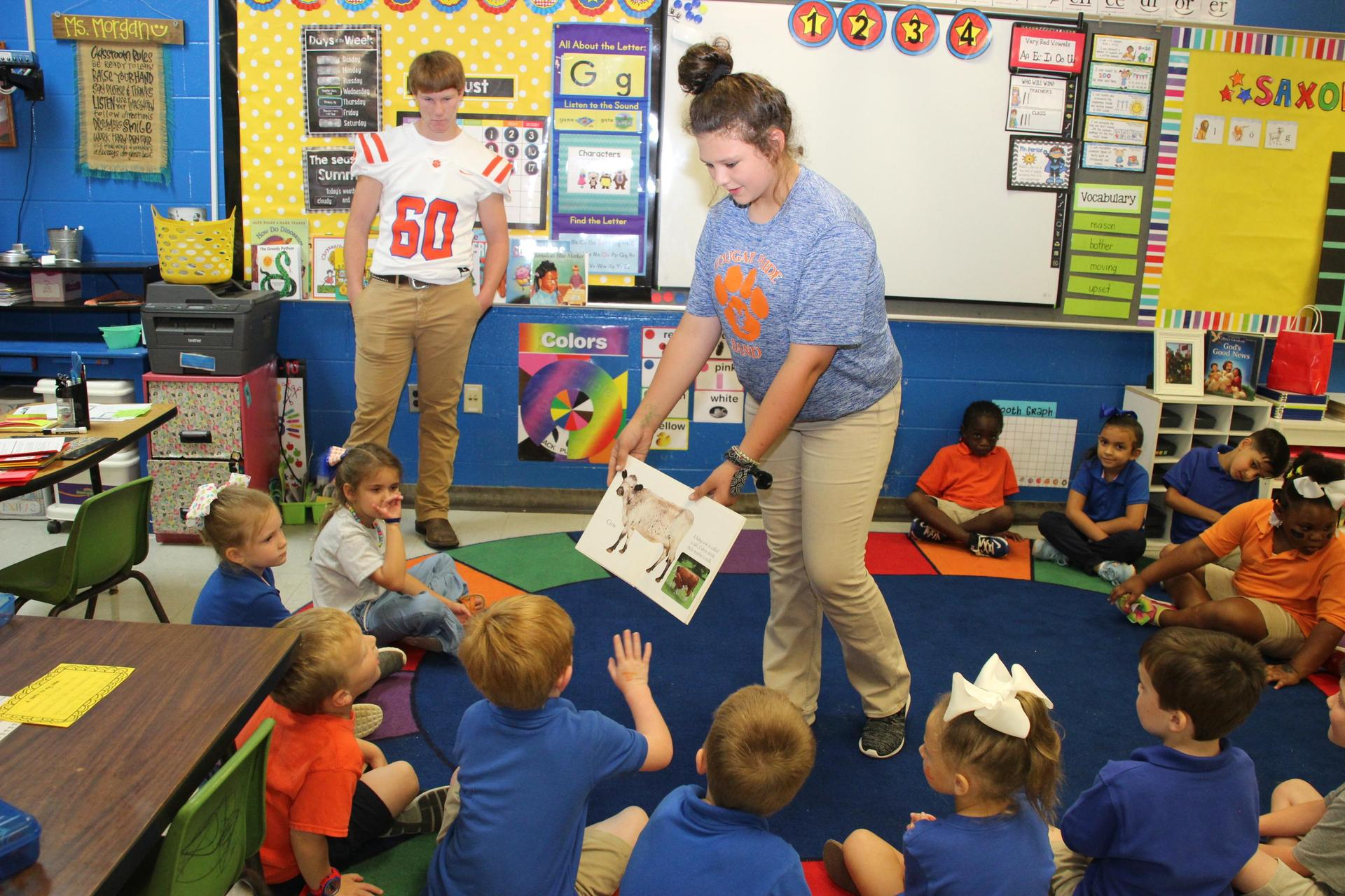 Students reading to K-5 students