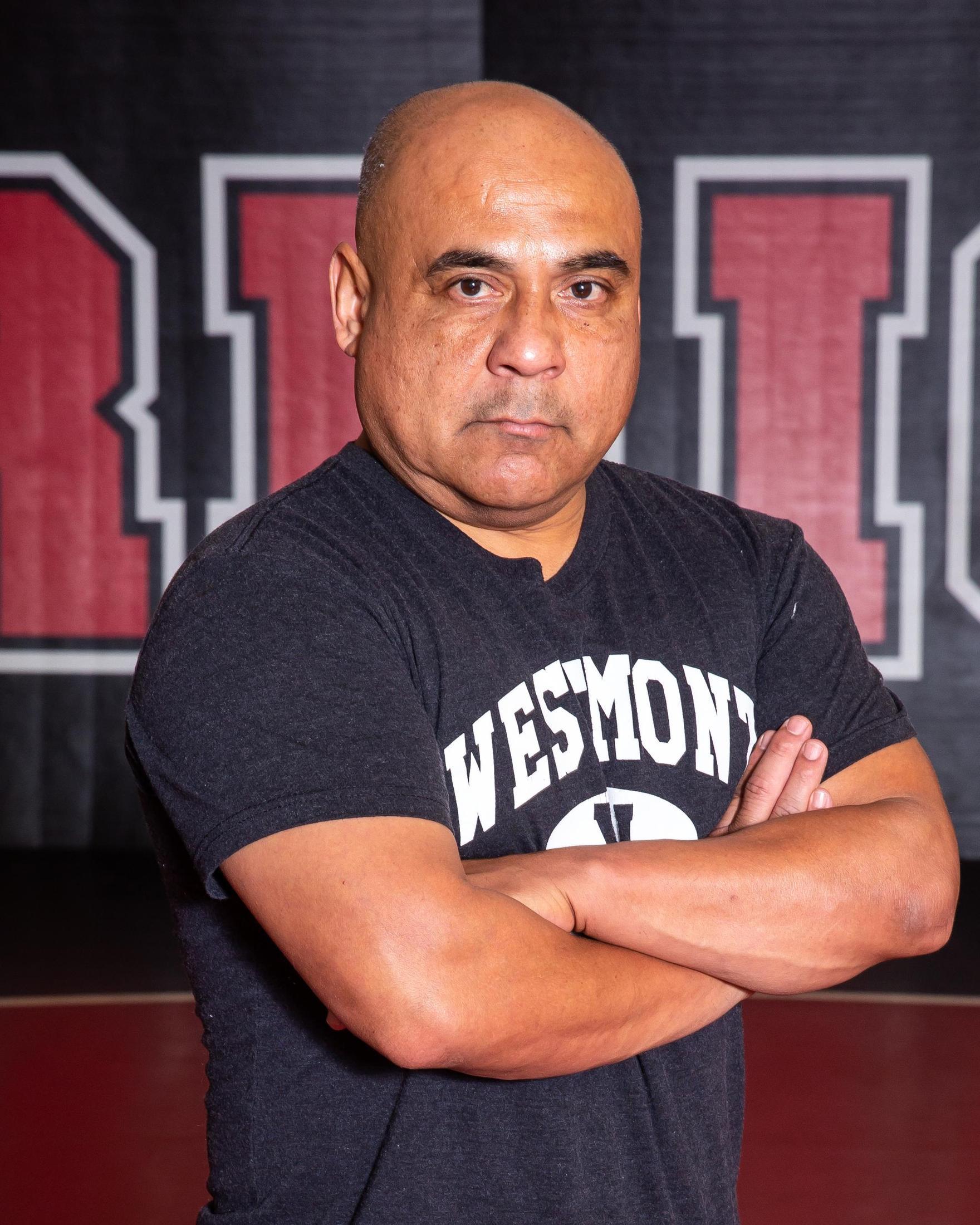 Head Coach, Andrew Flores
