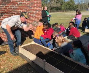 Students get a lesson in planting