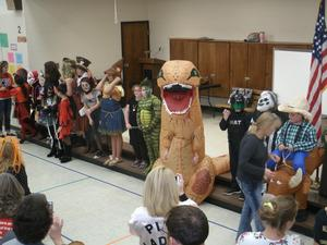 Fourth and fifth graders line up on stage for costume contest.
