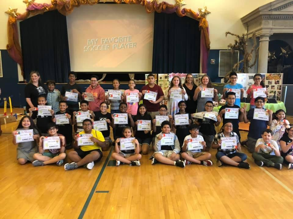 student with their awards and STEM teachers