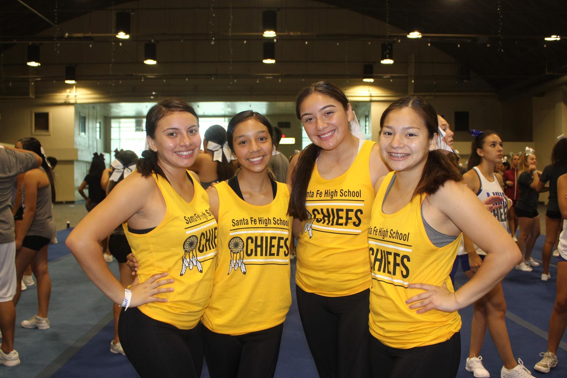 Four cheerleaders.
