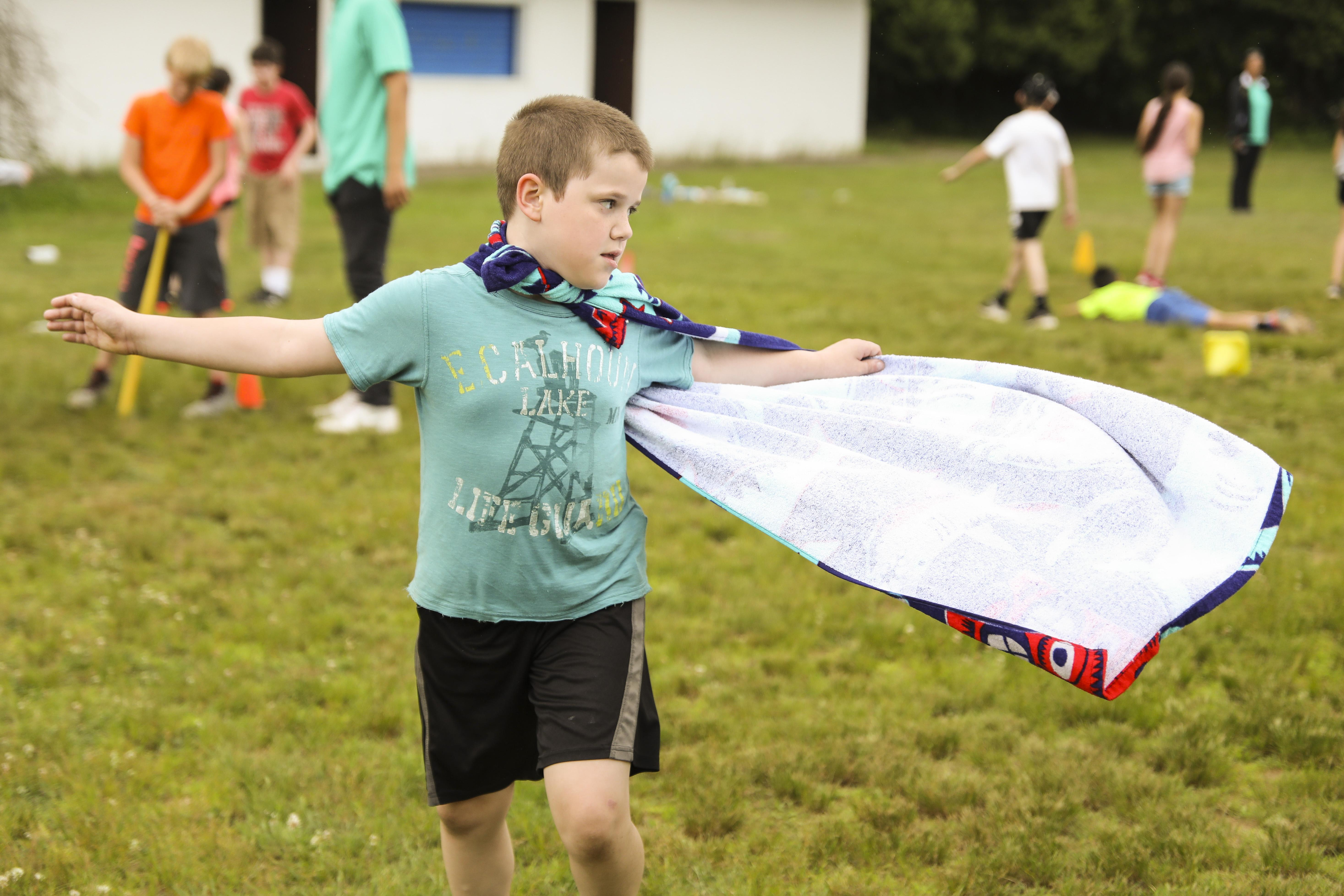 Boy twirling with cape