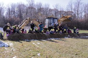 preschooler dig in the groundbreaking.