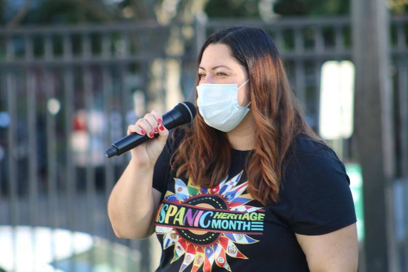 Woman speaking into microphone outside