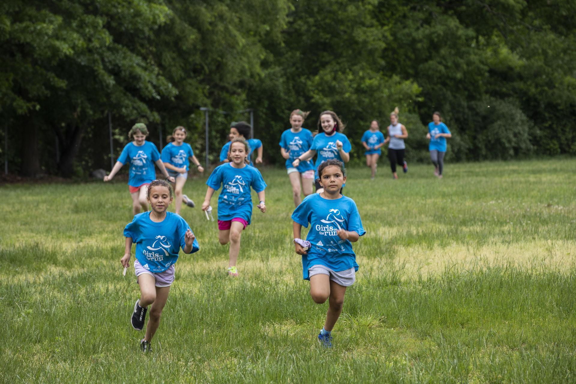 Students running through field
