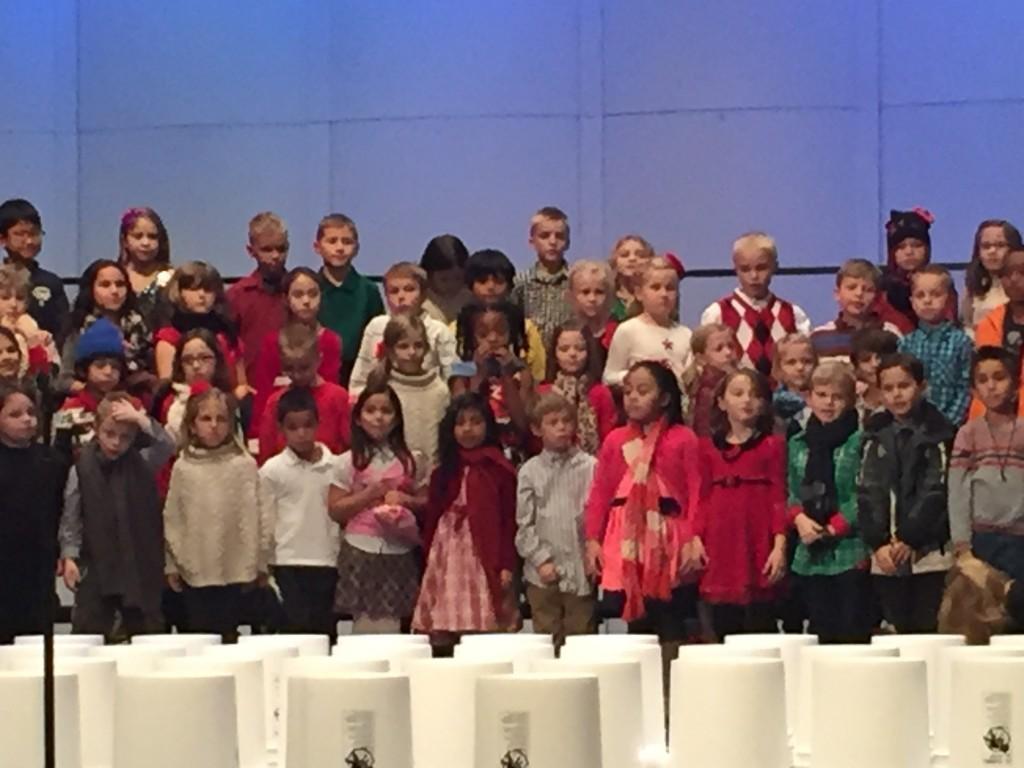kids sing on stage