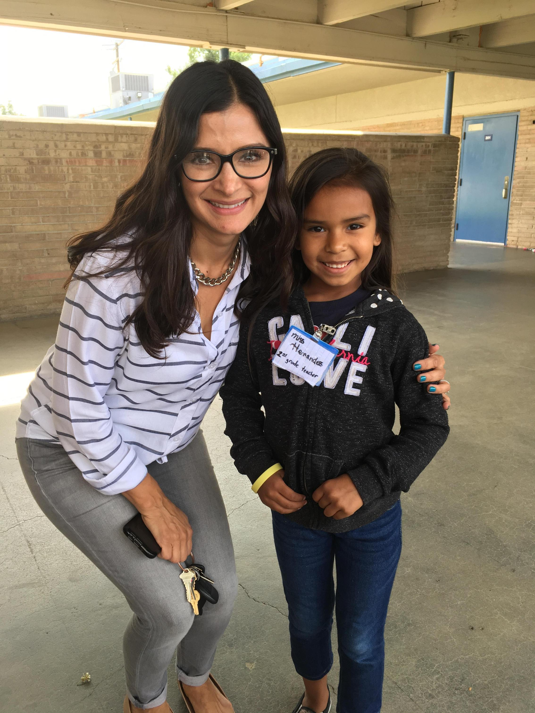Mrs. Hernandez posing with a student.