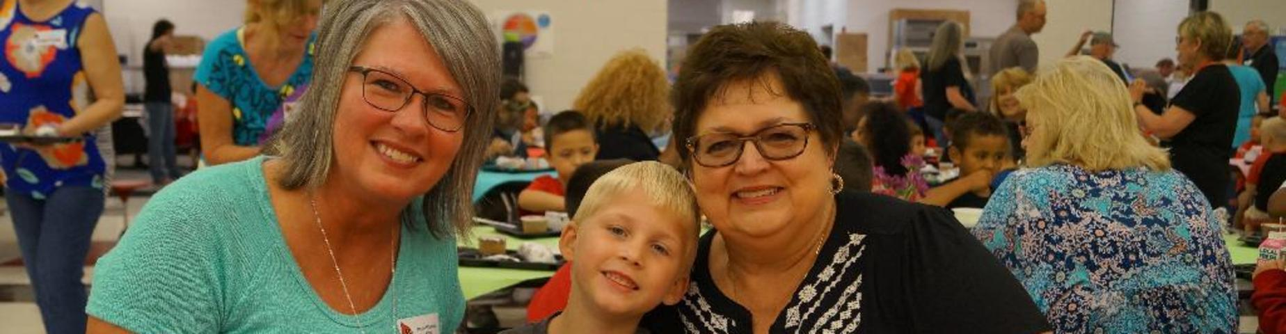 Grandparents enjoy breakfast with their grandchild at Mayfield Elementary