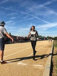 A 5th grade student finishing her race at the FMEA Track Meet.