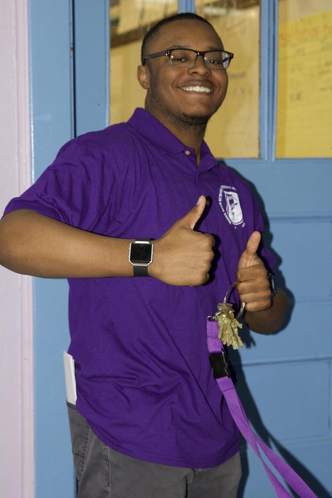Staff member smiling