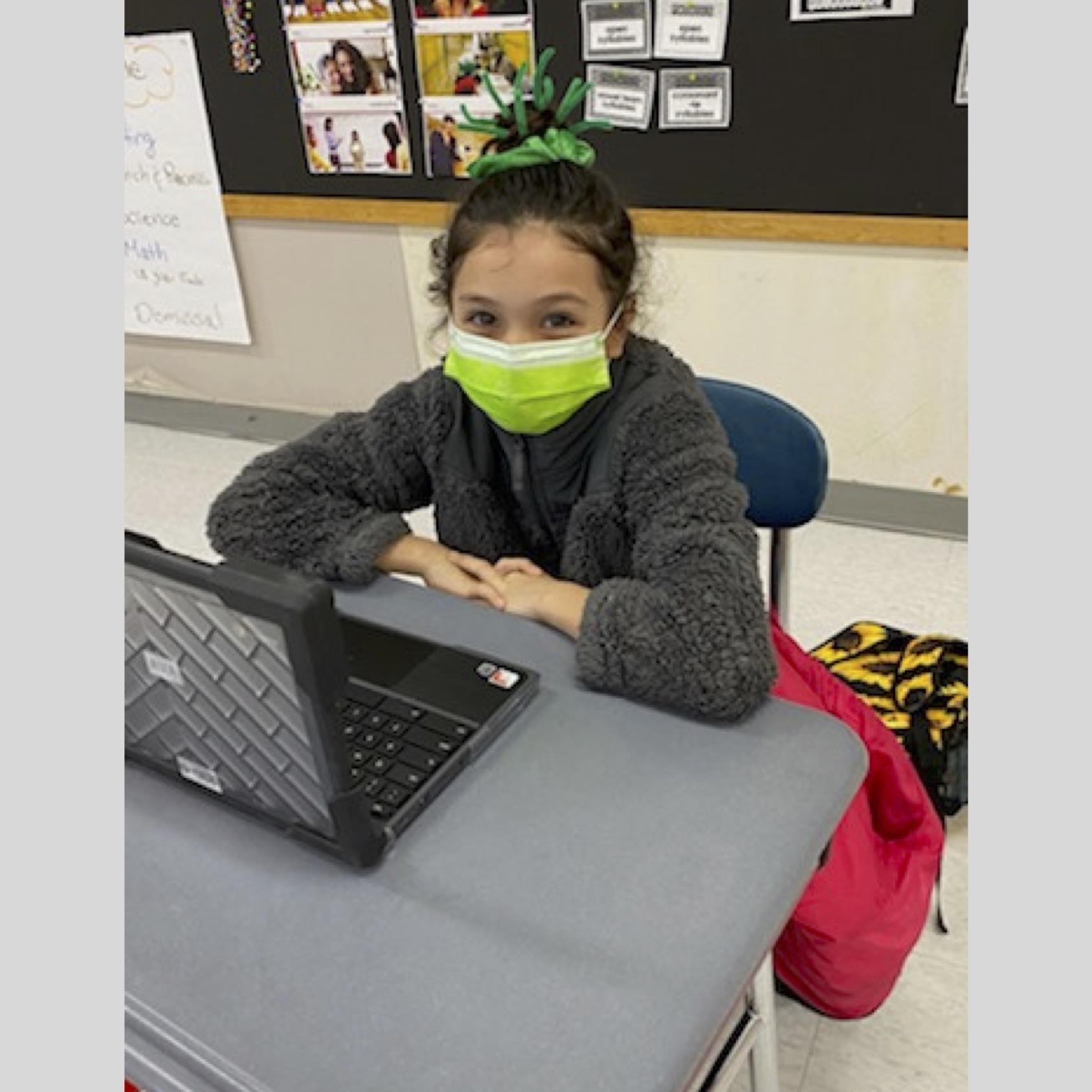 A student at Charlton Street Elementary School