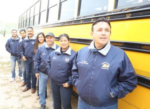 Eight members of the Reyes family get behind the wheel of a school bus every day to make sure students arrive safely to their campuses. Pictured front to back: ECISD school bus driver Juan Martin Reyes, ECISD school bus driver Eva Reyes, ECISD school bus driver Luis Ramon Reyes, ECISD school bus driver Eva Maria Reyes Ruiz, ECISD school bus driver Obed Ruiz, ECISD school bus driver Antonio De Jesus Reyes and ECISD school bus driver Sergio Reyes.  Not pictured ECISD school bus driver Claudia Valdez-Molina.