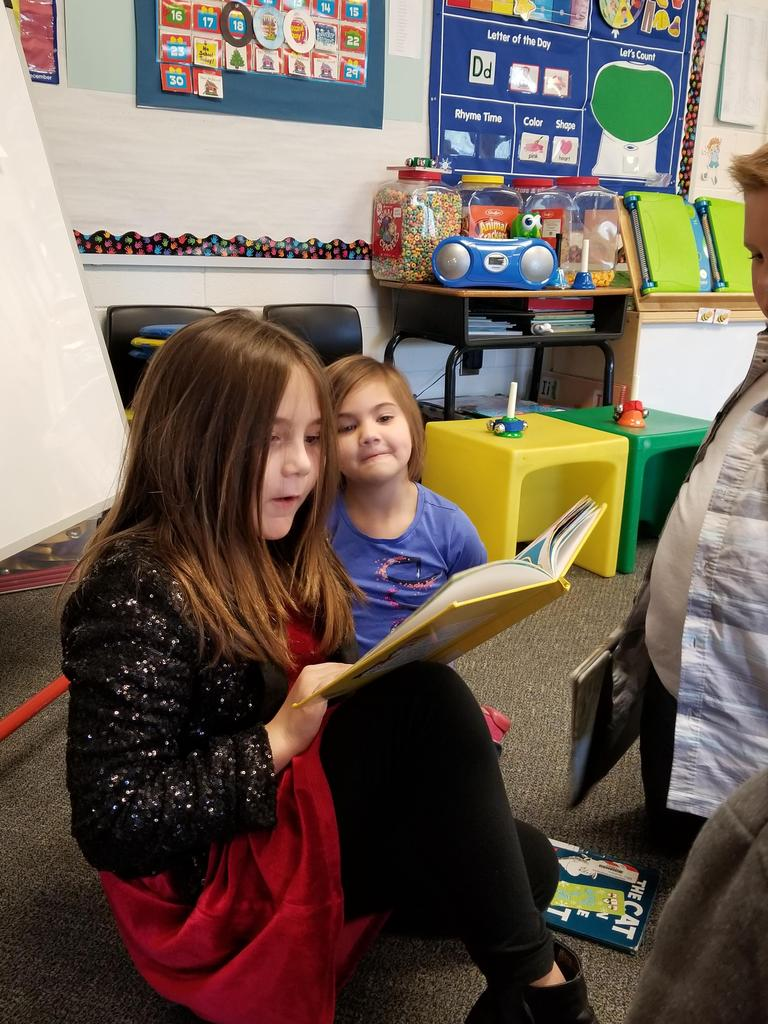Students in 4th Grade reading to Preschool PALS
