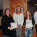 Kellie Marlow, Karen Bromps and Ashleigh Greule receiving the award