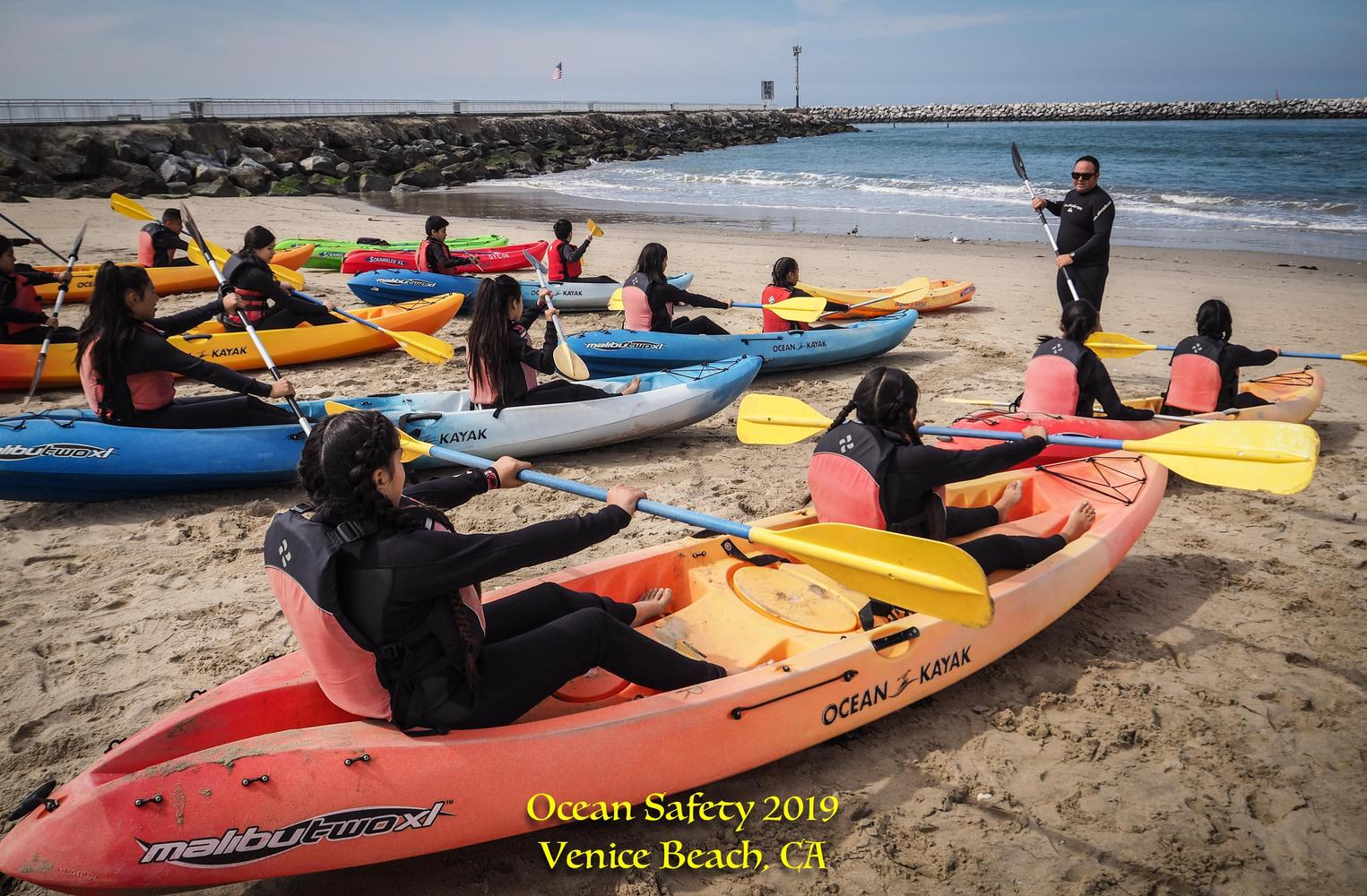 students learning how to kayak at venice beach