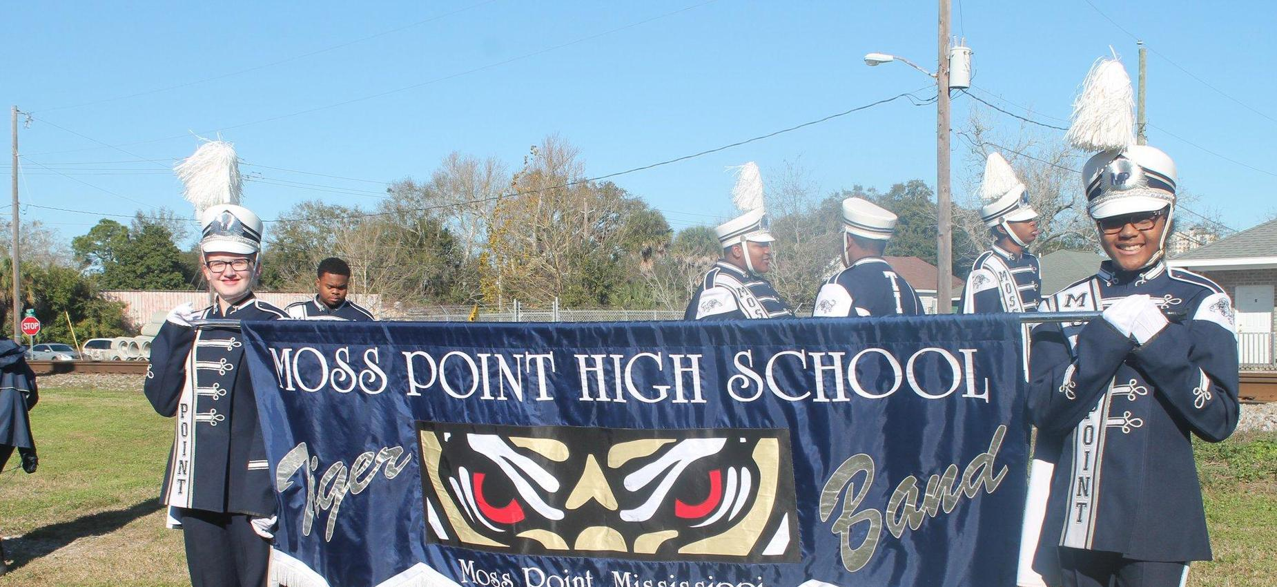 Band members holding a banner