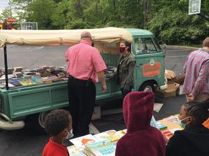 Mr. Lindsay with book bus handing out books
