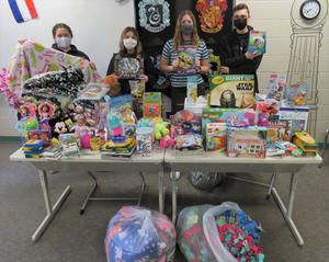 TKHS National Honor Society officers are pictured with the numerous toys, blankets and items to donate to Helen DeVos Children's Hospital.