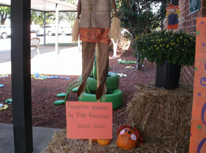 Fall decorations with pumpkins painted by pre-school.
