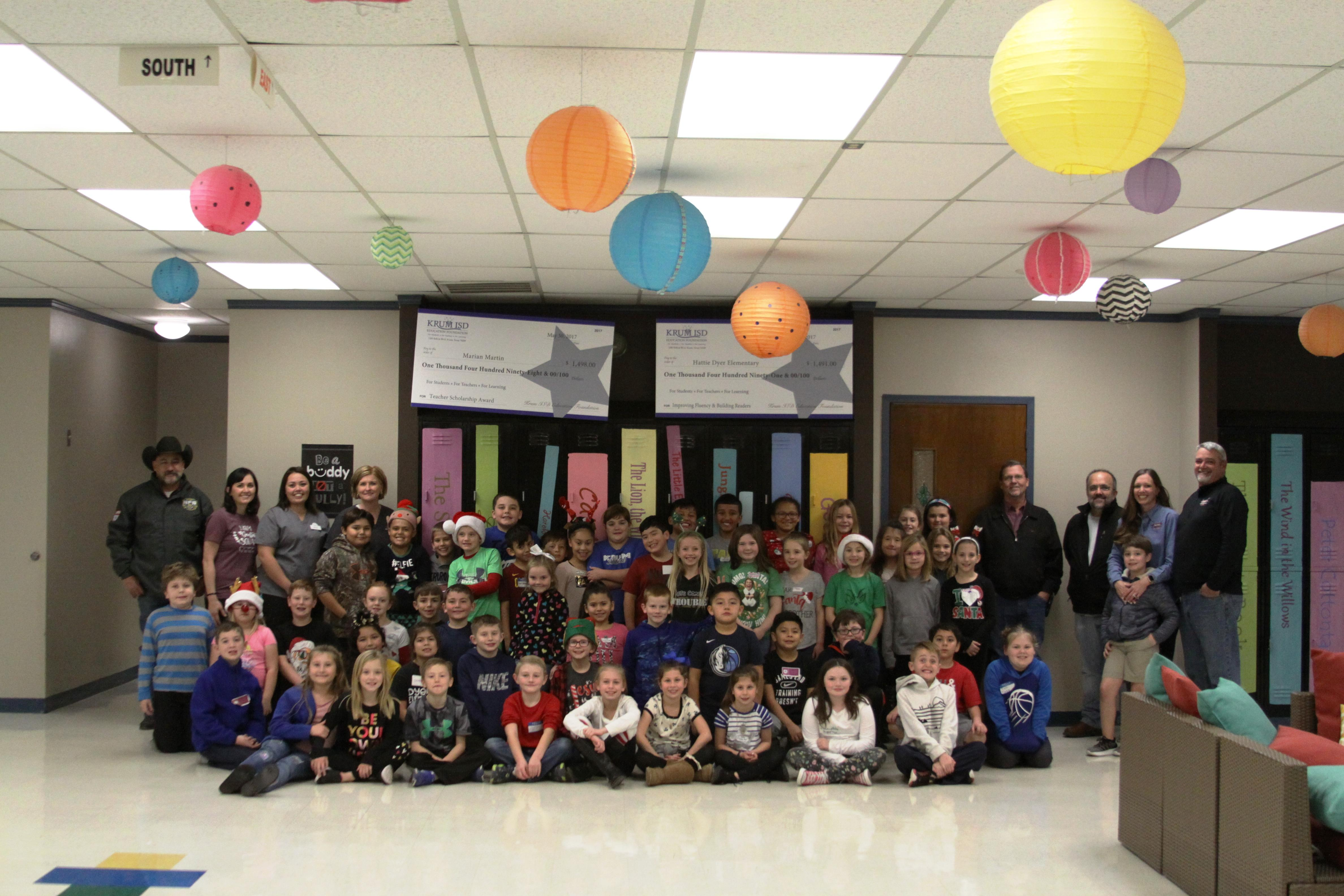group photo of third grade safety patrol and local business owners