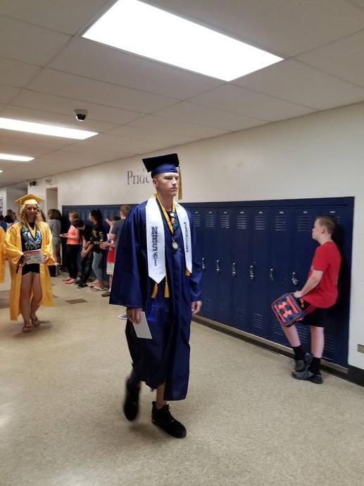 Graduates walking through WMS
