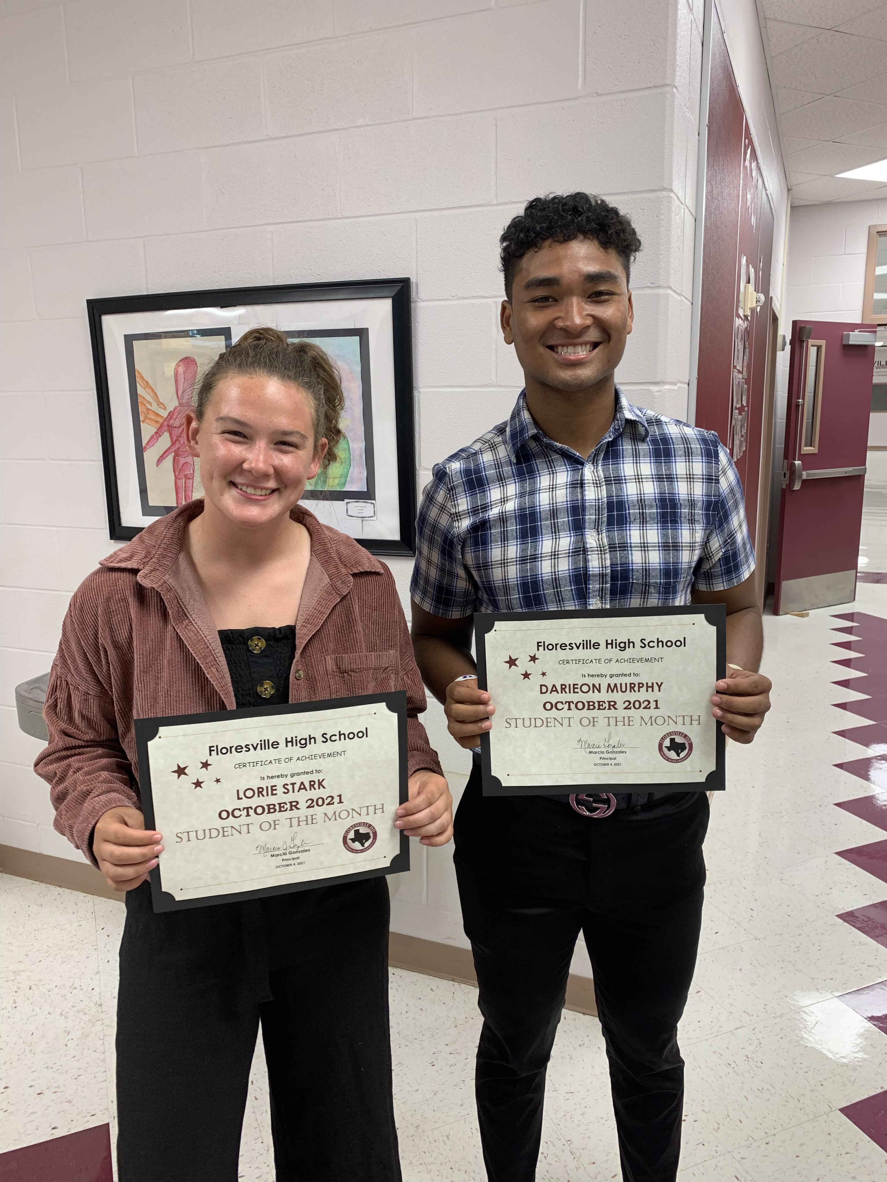 two students with certificates