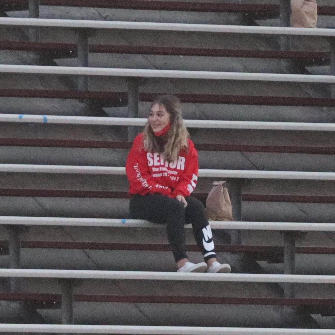 students and staff sitting in bleachers