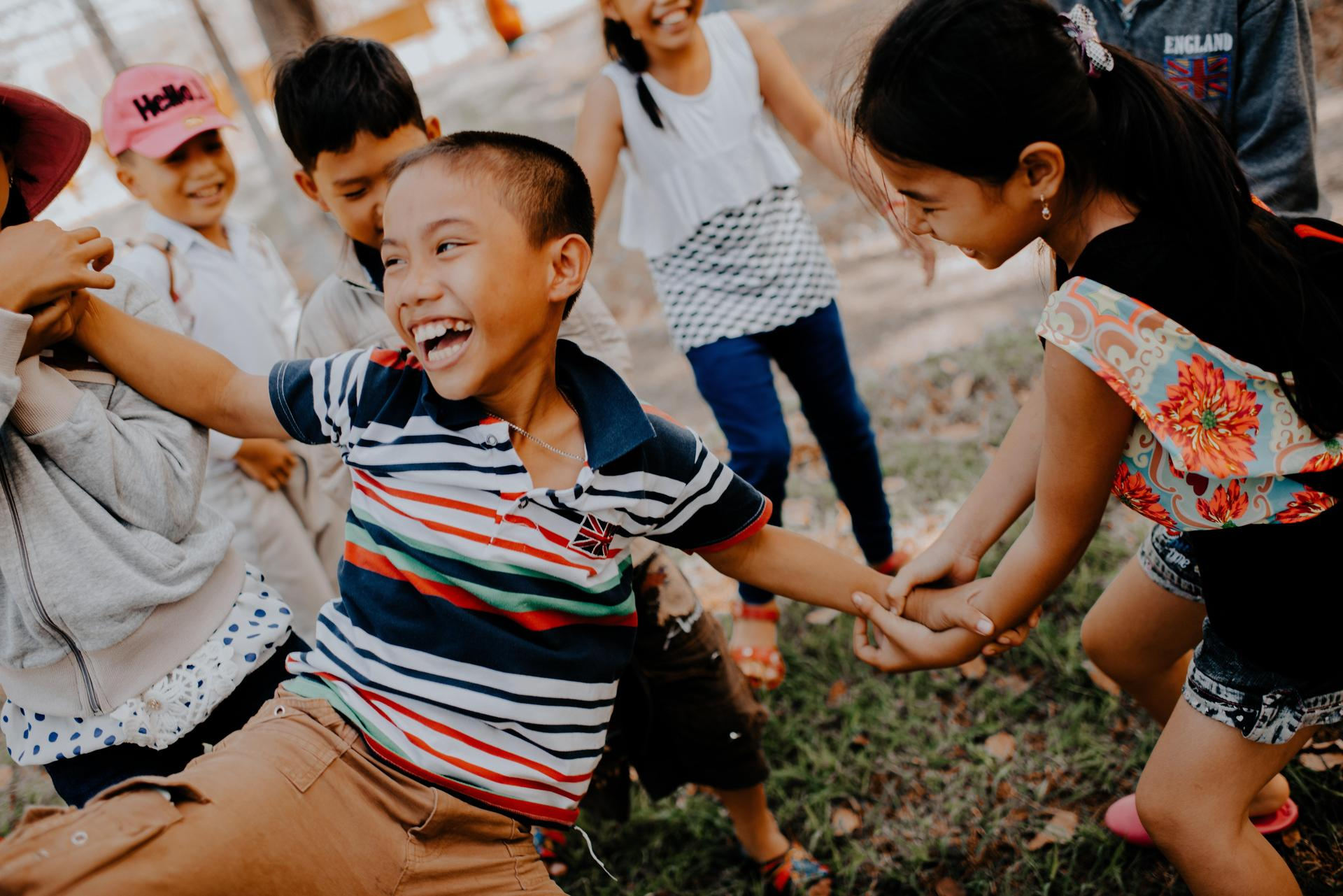 children laughing and playing outside