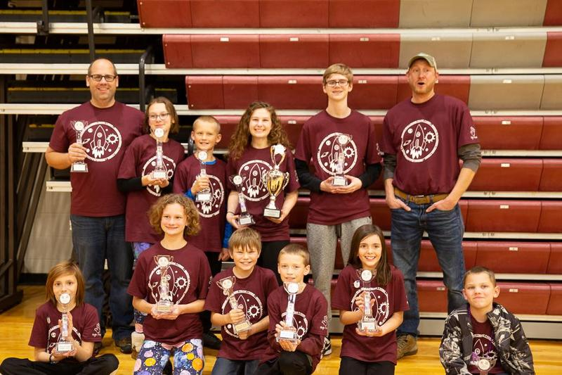 elementary lego league team in gym with trophies
