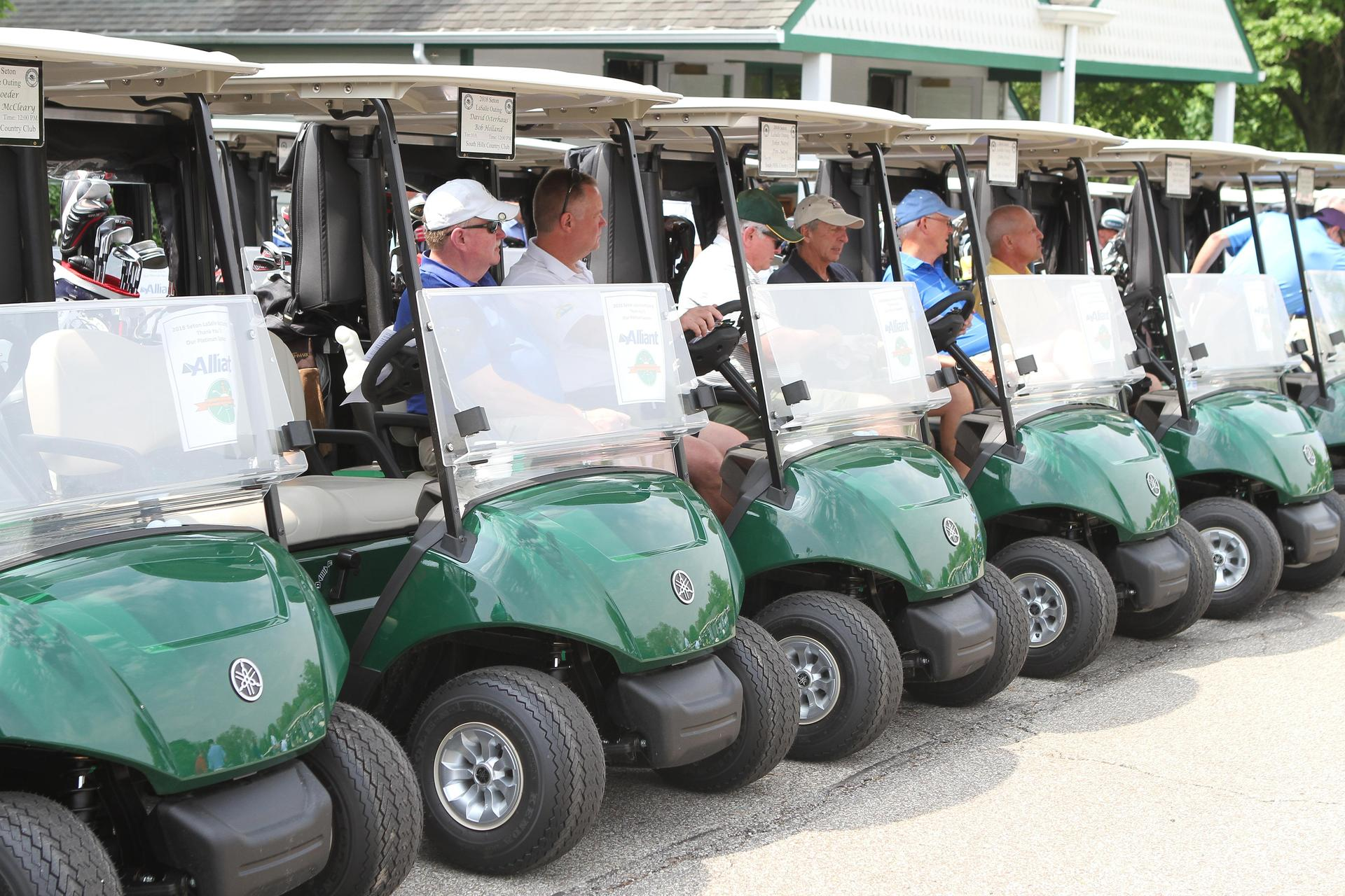 golf carts lined up at Rebel Classic