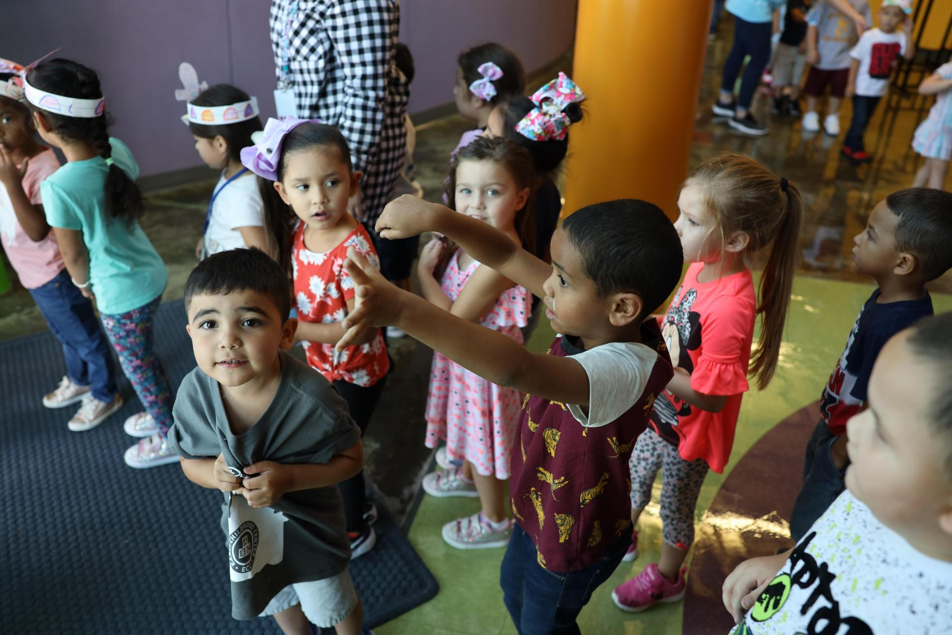 Early Childhood Center students searching for The Gingerbread Man!