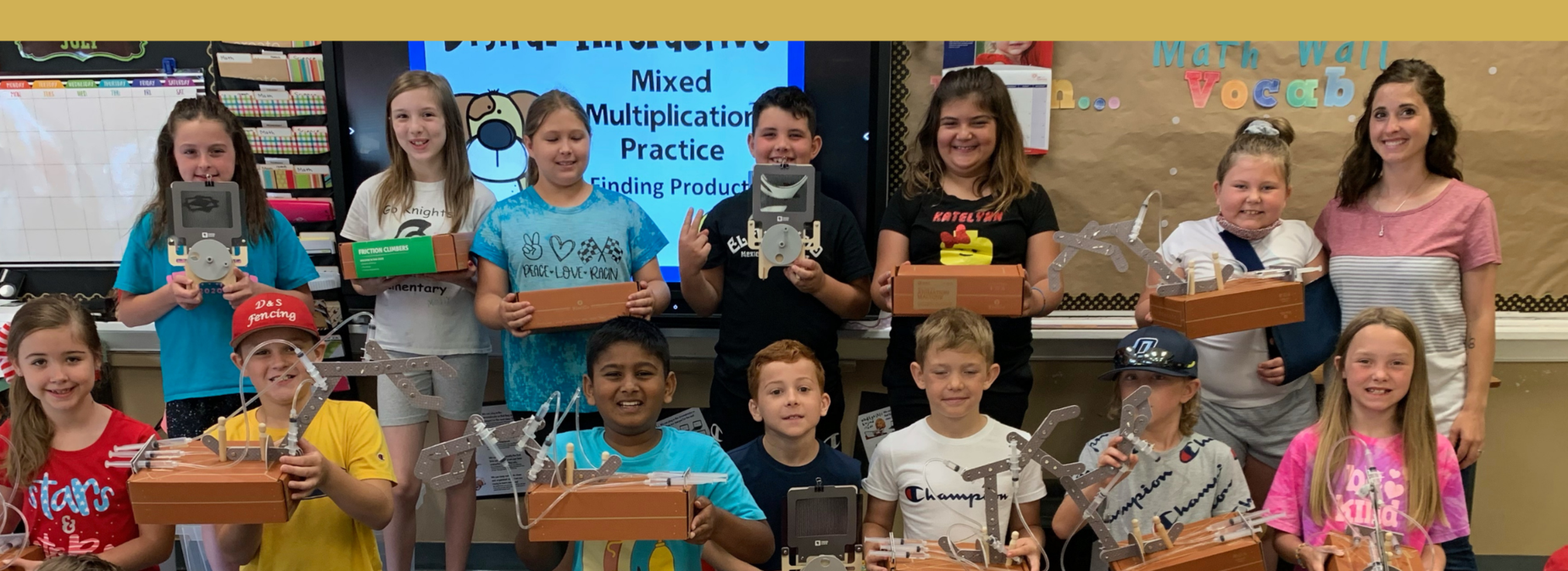 Students showing their finished STEM projects from the Summer Learning Academy.