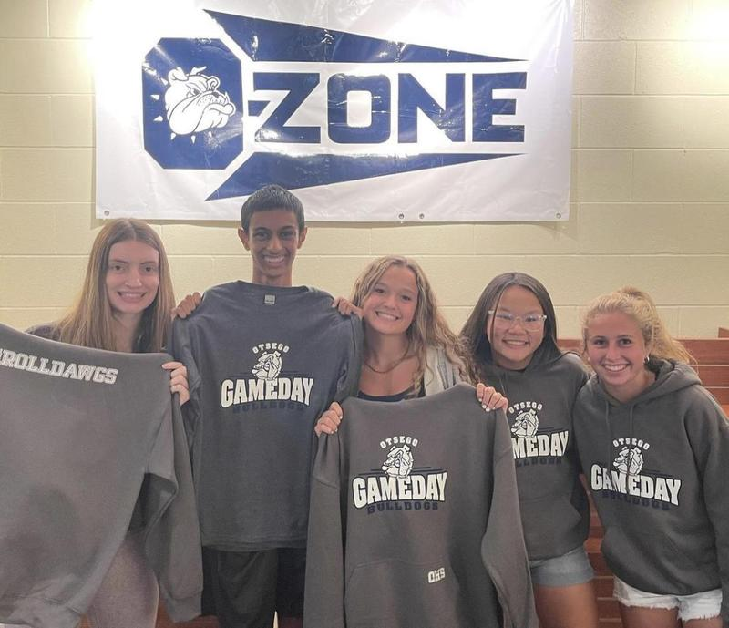 Students hold up Game Day gear