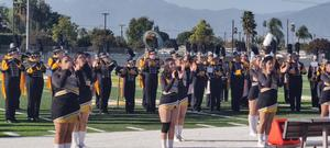 Cheer and band play for ribbon cutting
