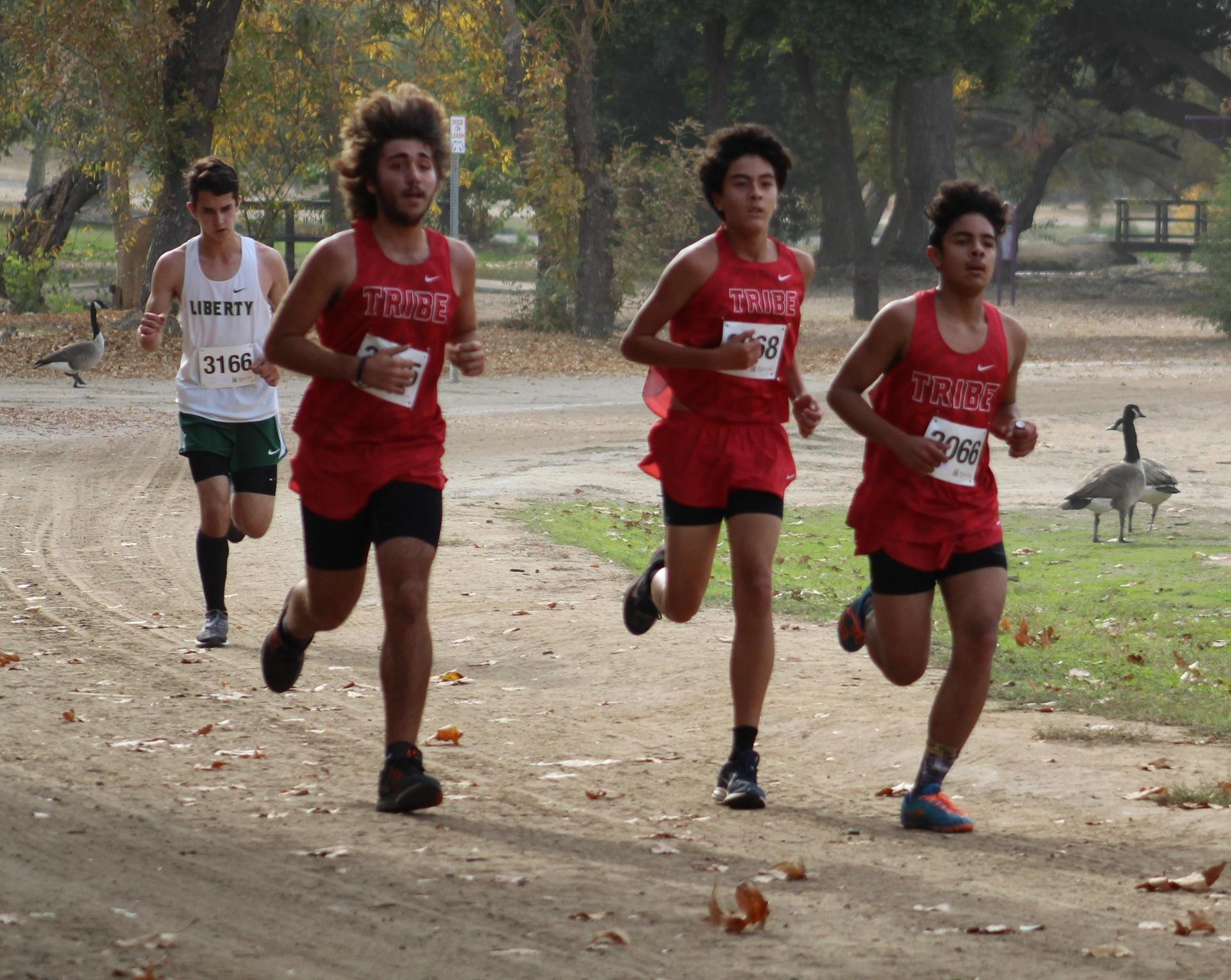 Antonio Brasil, Nicholas Lopez and Angel Gonzales running