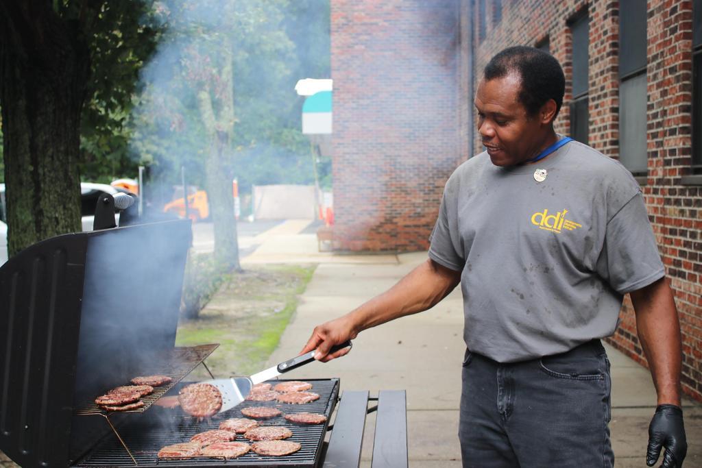 Staff enjoying DSP Week BBQ hamburgers