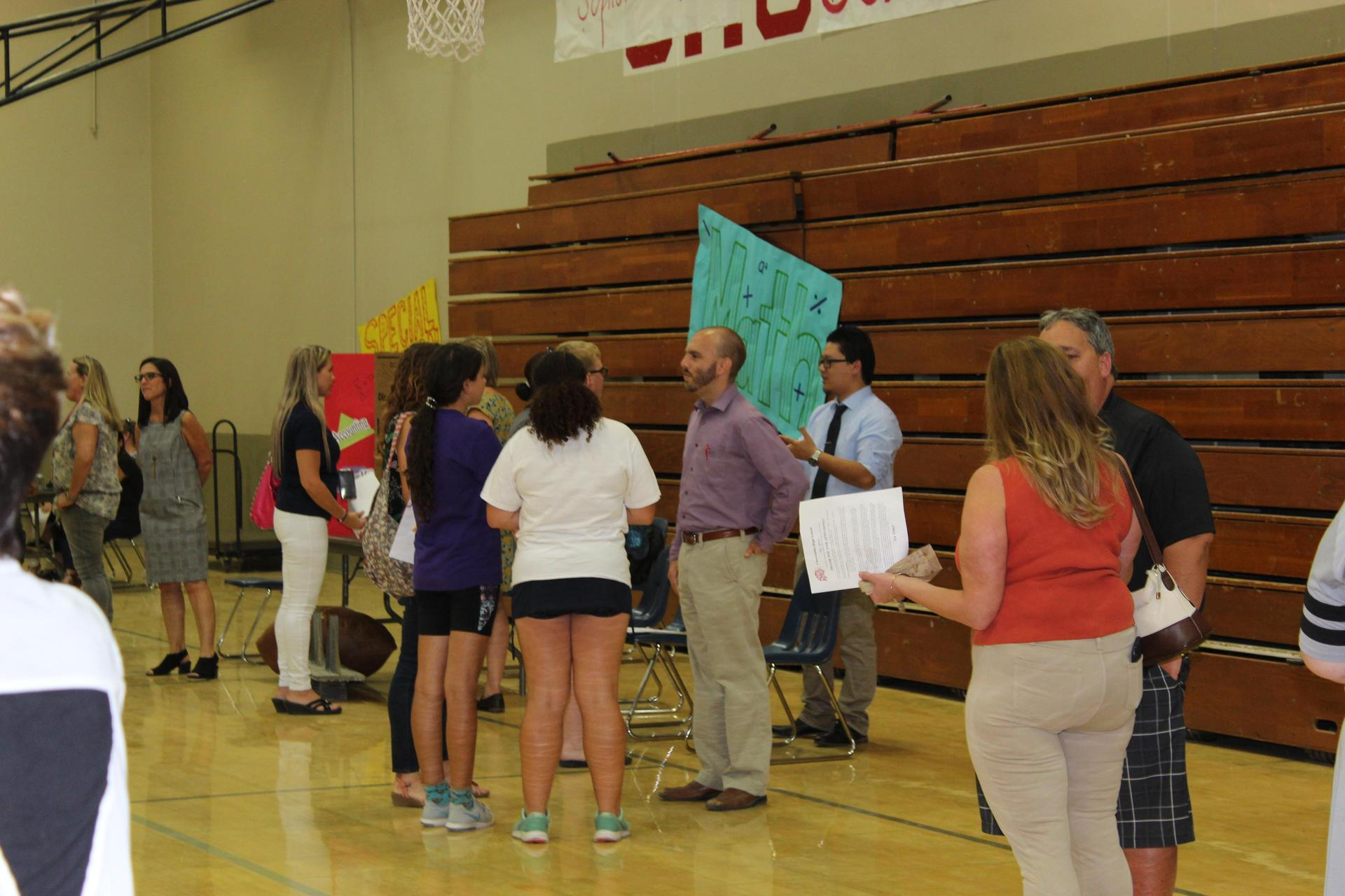 Teachers, parents and students at the back to School Carnival
