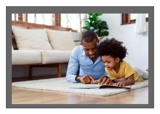 Image of parent reading to child