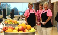 3 high school cafeteria staff members serving breakfast
