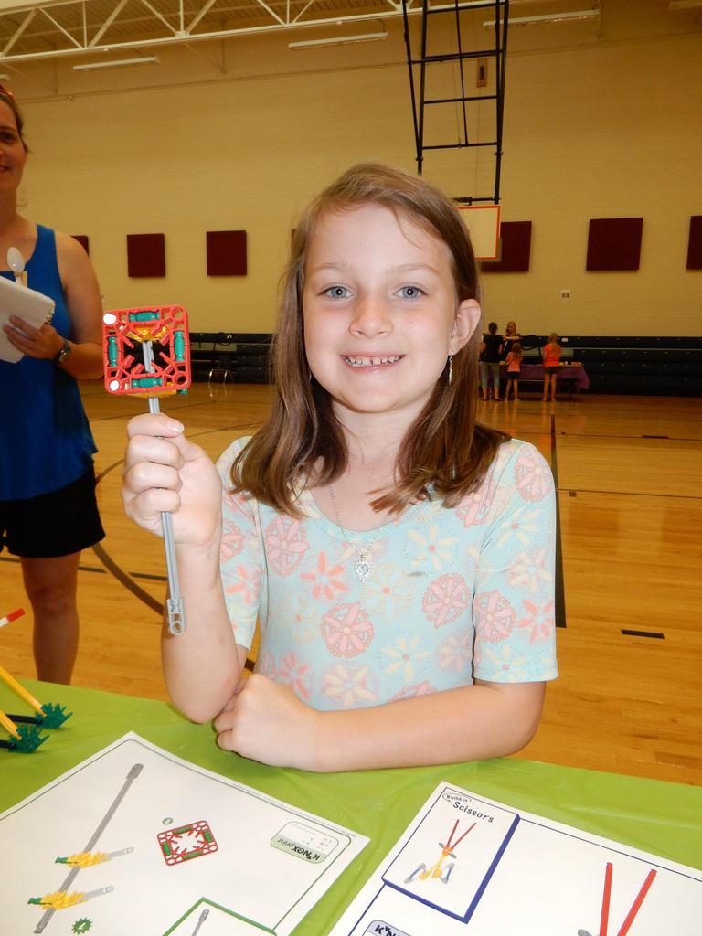 Student completing STEAM activity with Knex