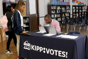 Students at KRHS are handed voter registration forms to fill out