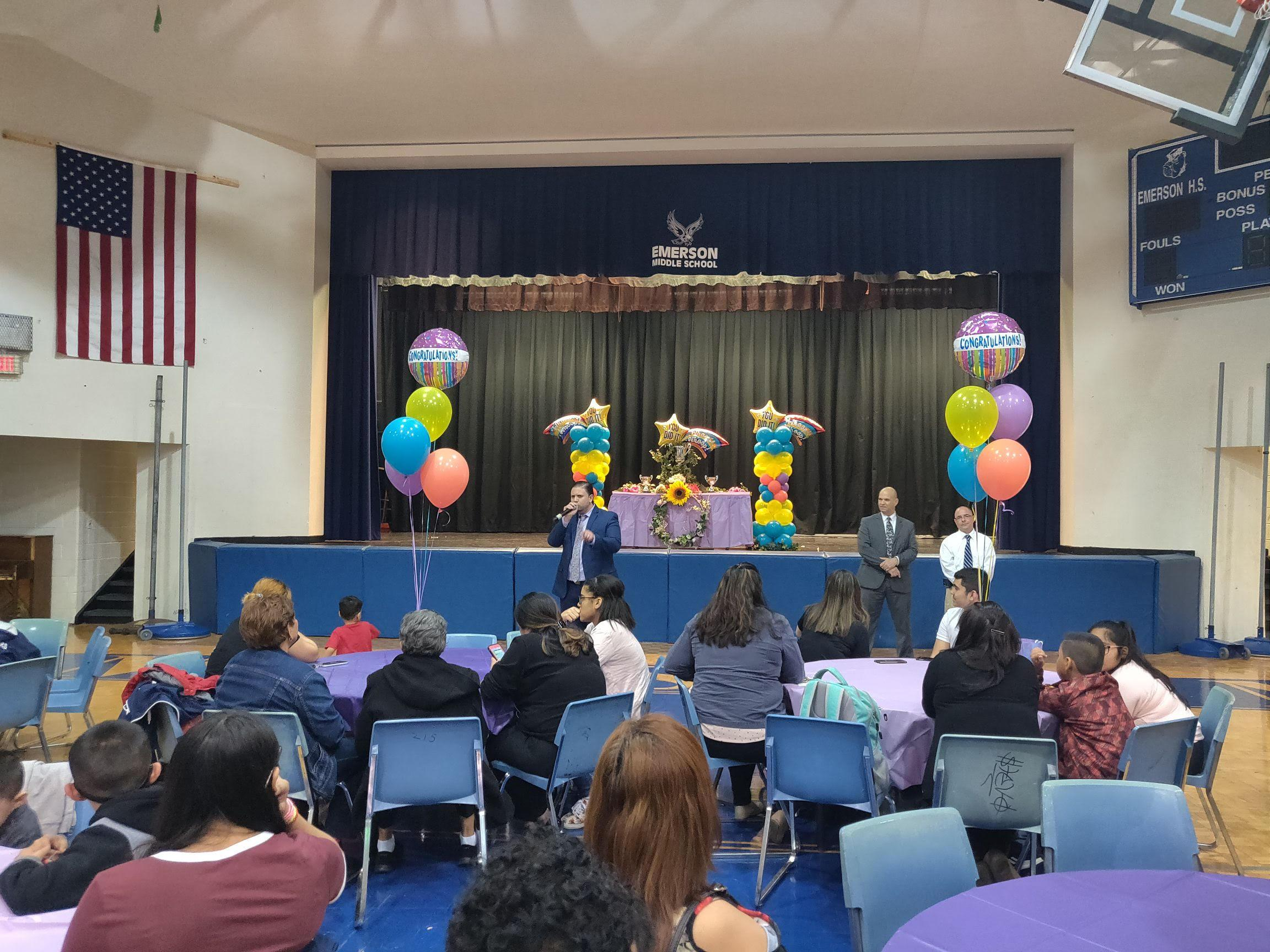 Mr. Abbato addressing the parents with Mr. Aleman and Mr. Higuera at the stage